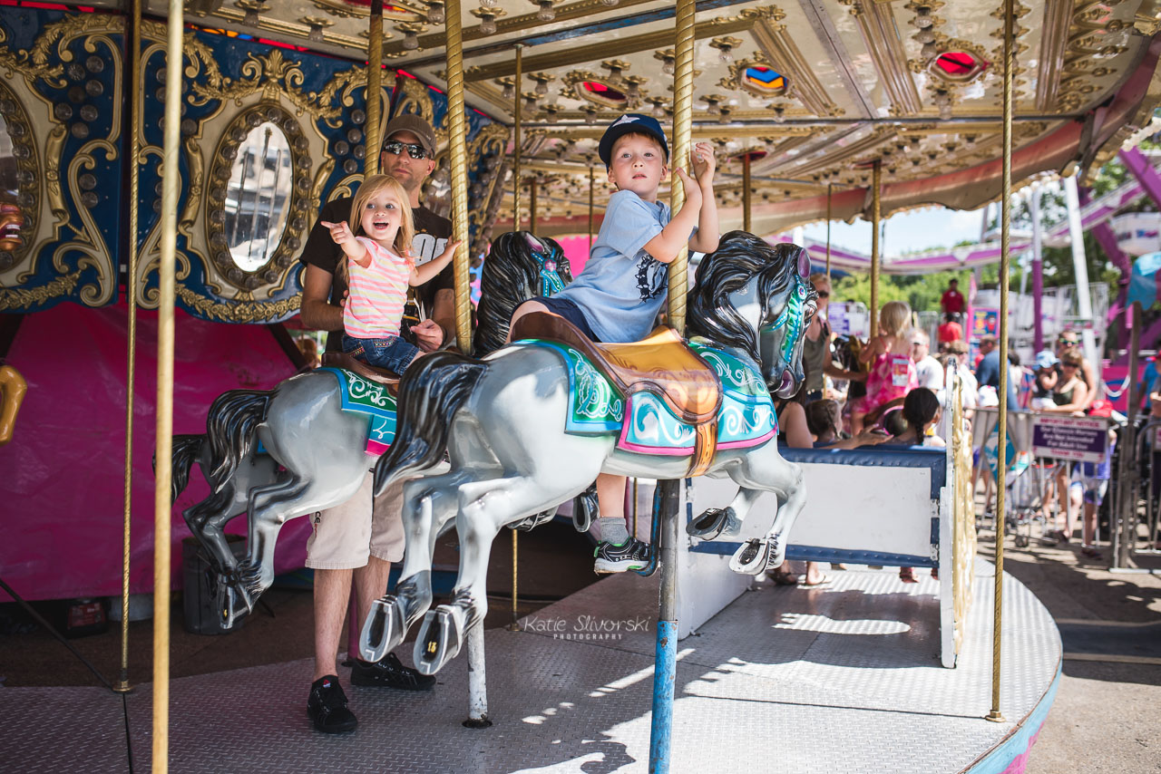 two kids on a K-days carousel