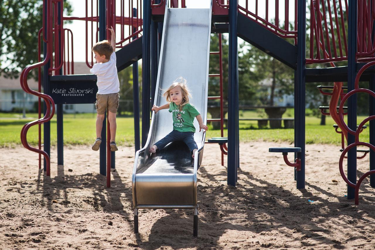 Edmonton best photographer photo of kids playing on playground