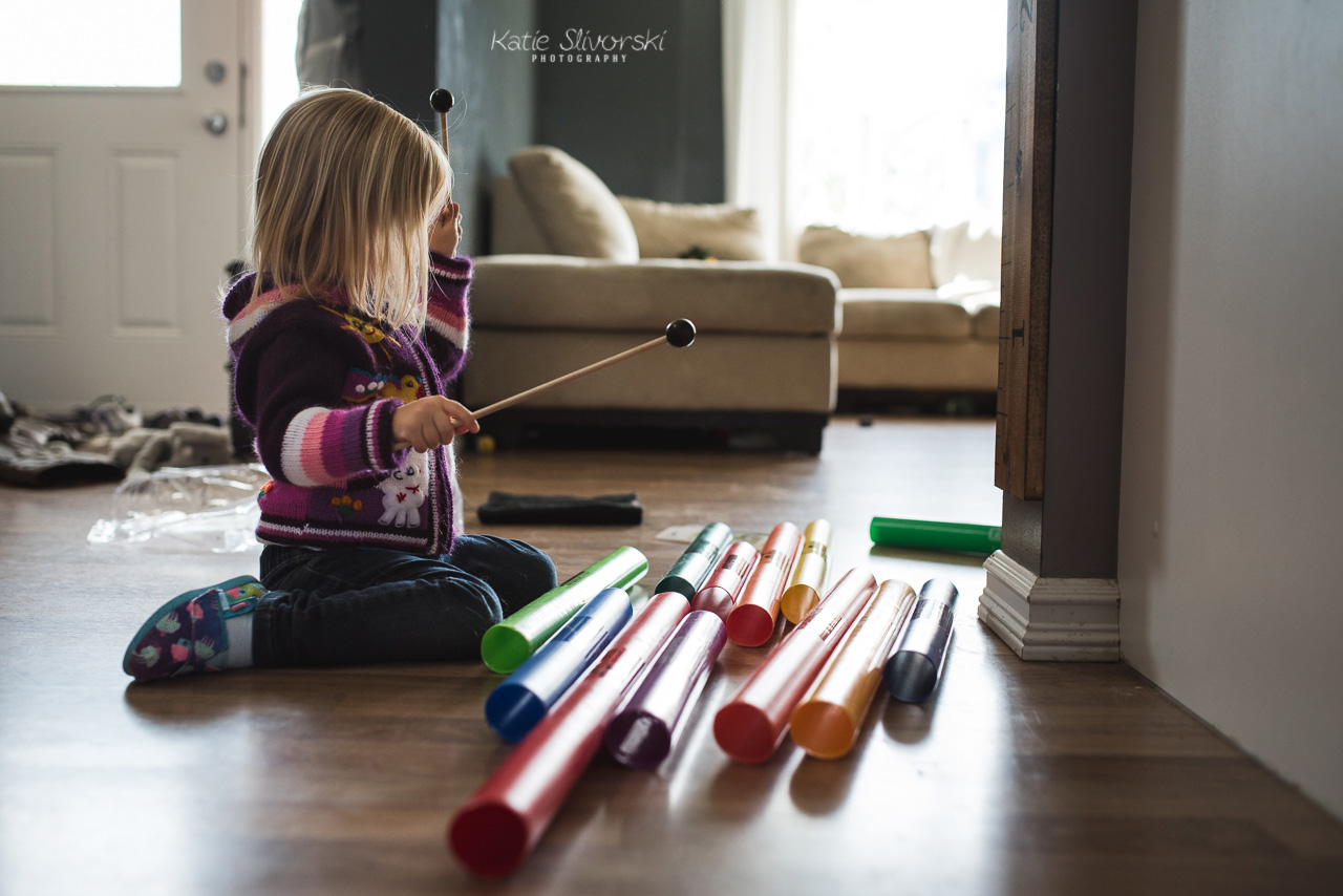 girl playing with boomwhackers