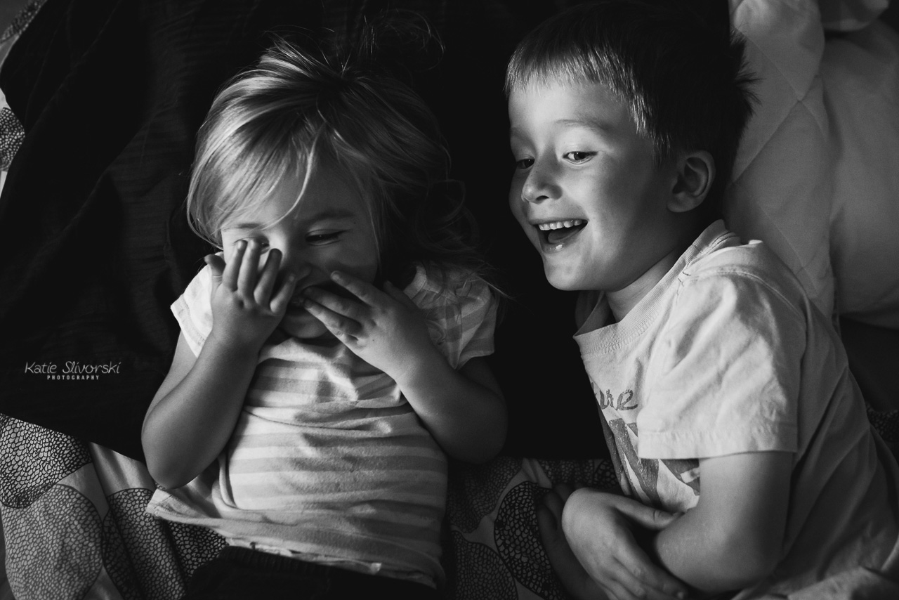 two kids laughing