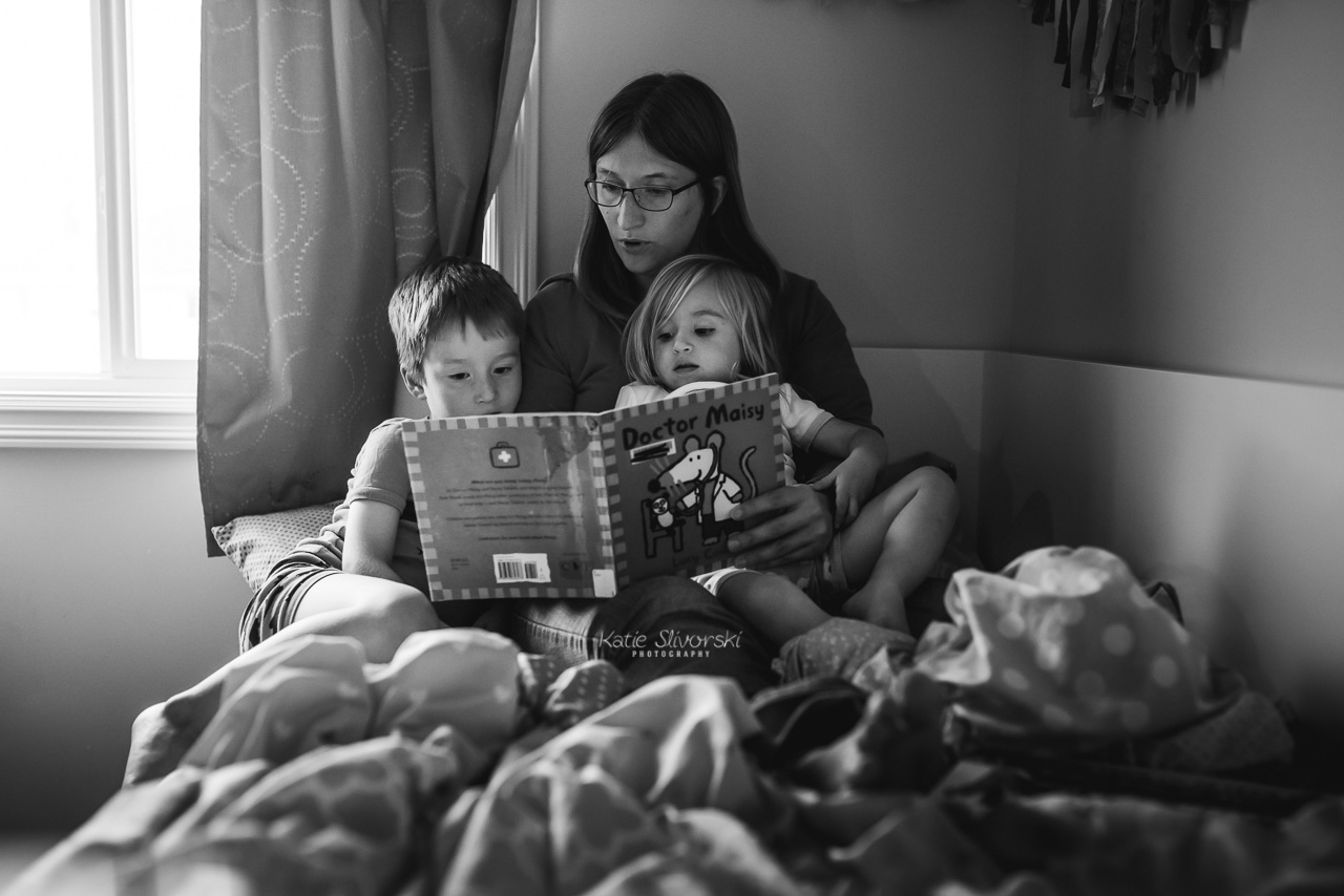 mom reading book to kids in Edmonton