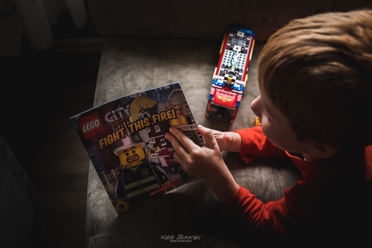 Child reading Lego book in Edmonton