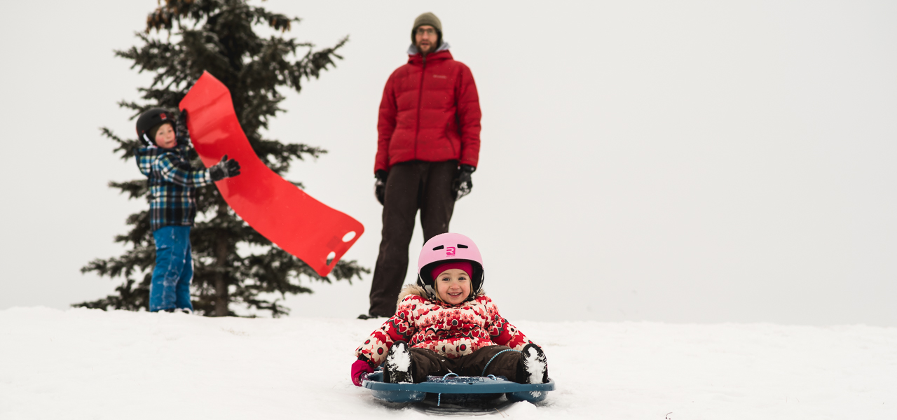 kids sledding in Edmonton hills
