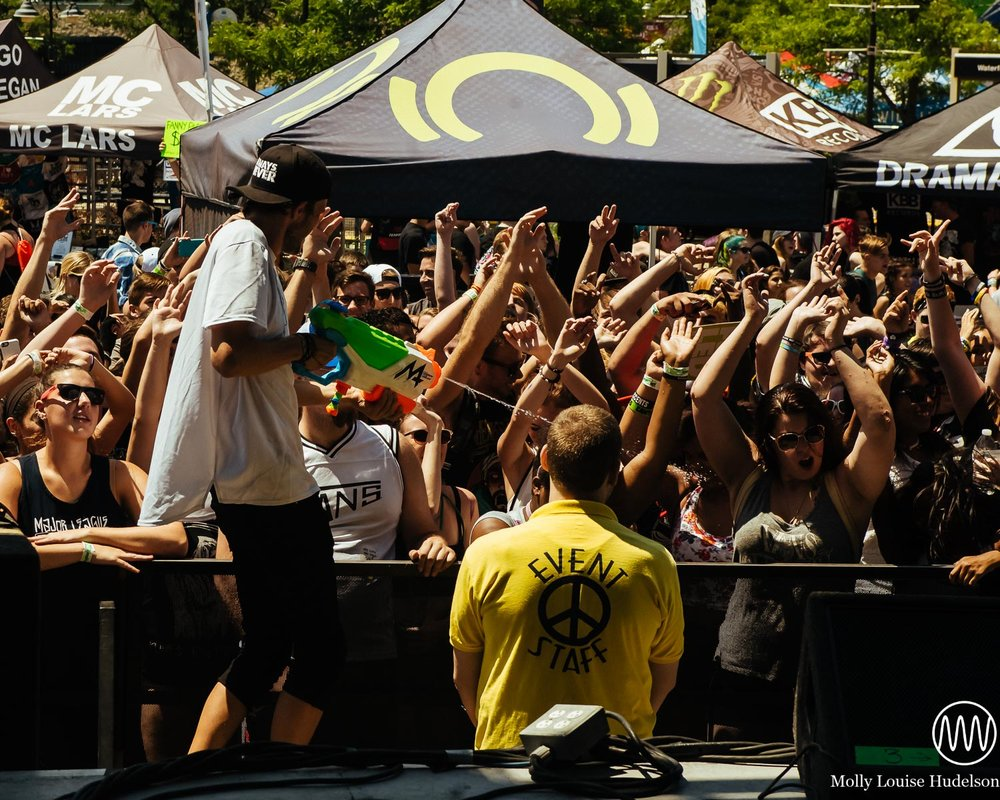 M4SONIC's tour manager TC spraying the crowd / 7/10/15 / Vans Warped Tour / Camden, NJ