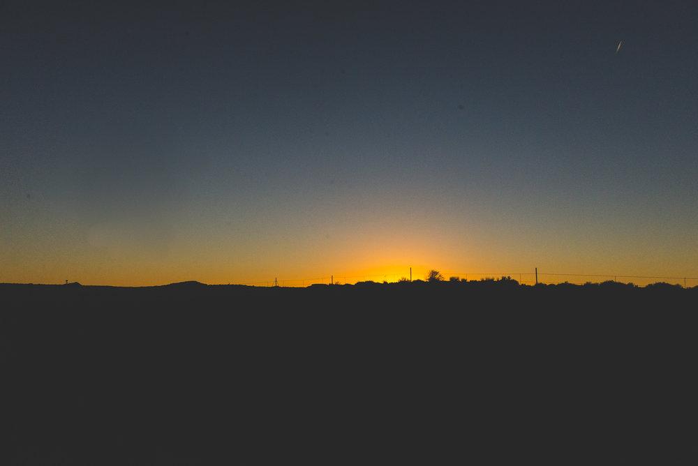 The sun setting behind the horizon. / 2/9/16 / Holbrook, AZ