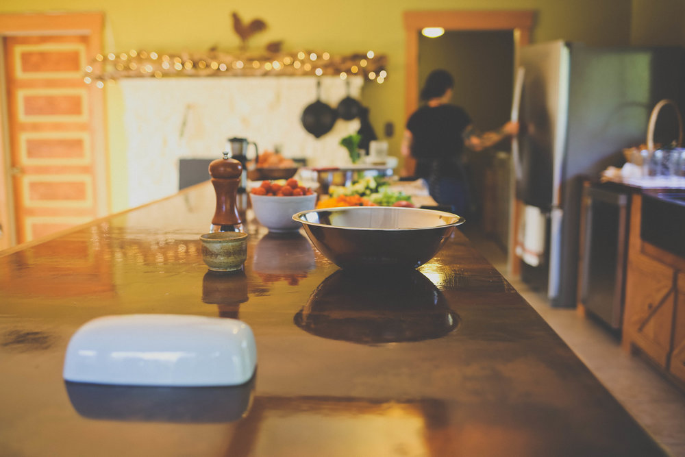 Our kitchen seats 16 people and features plenty of room for cooking farm to table meals. Please inquire about organic local food and private chefs for your retreat.