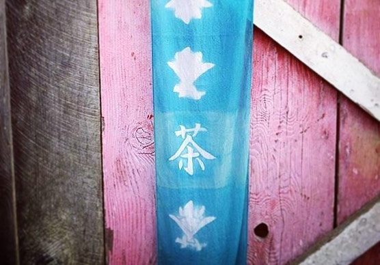 Fresh indigo grown at North Fork 53 this year was used to dye this silk banner. Our friend Brittany Boles at SeaFolk Artisans made a hand carved wood block for the symbol of tea to honor our new journey. She dyed this with fresh batch indigo! It's amazing what plants and people can do.