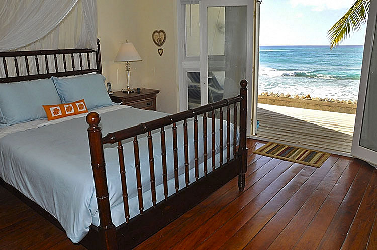 Beachfront Access. . .aqua house bedroom one. . .UNIT ONE