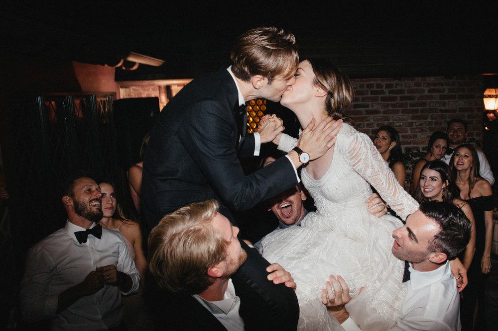 Bride+and+Groom+Lifted+in+Air.jpg