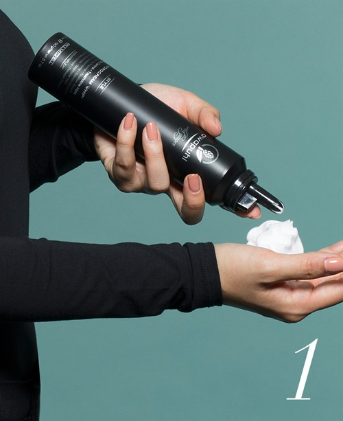 On damp hair, apply  HydroCream Whip  and brush through to distribute it evenly.