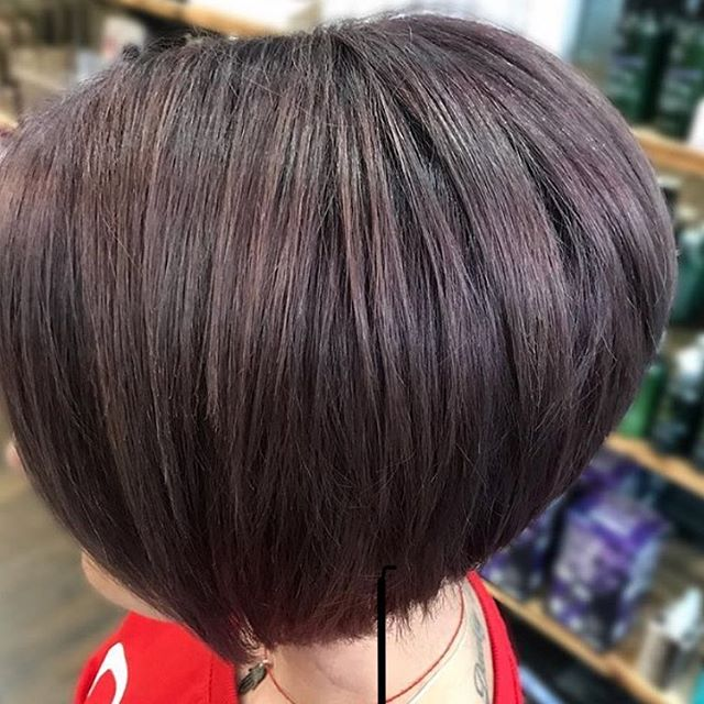 We love this smoky amethyst colour and sharp graduated bob by Becky.