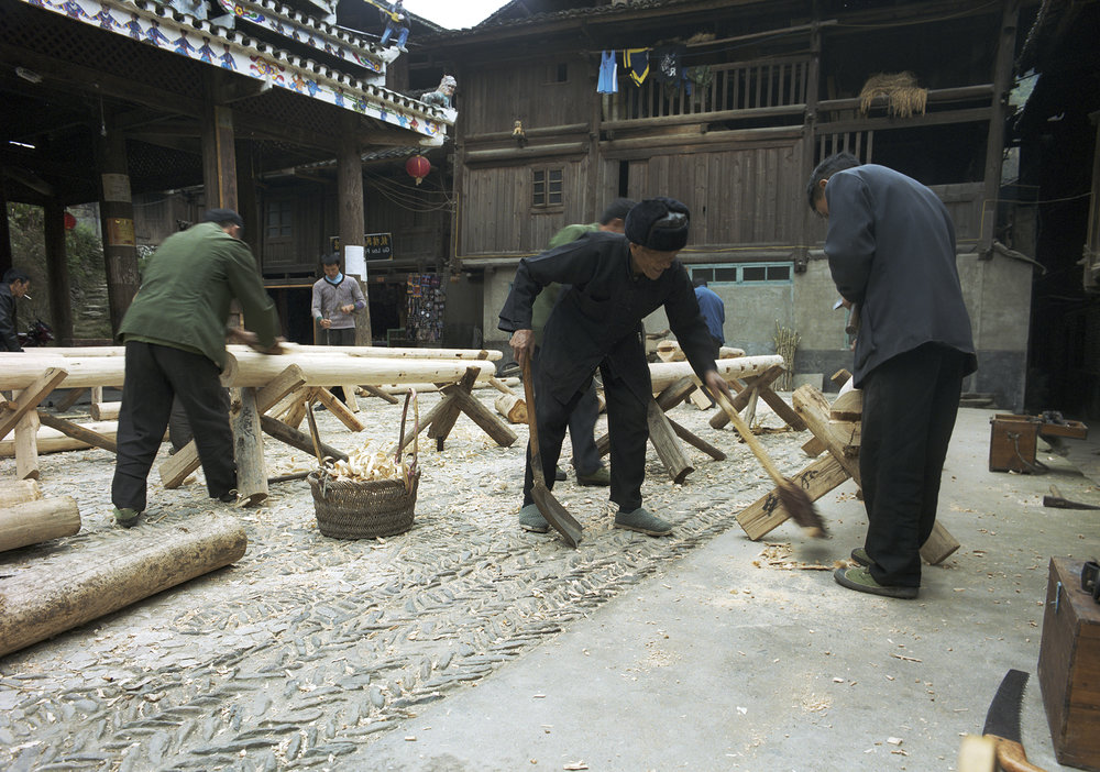 Carpenters at work in the main courtyard.
