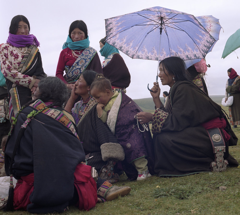 2007 Qinghai - women at the festival, wearing their best clothes and jewelry.