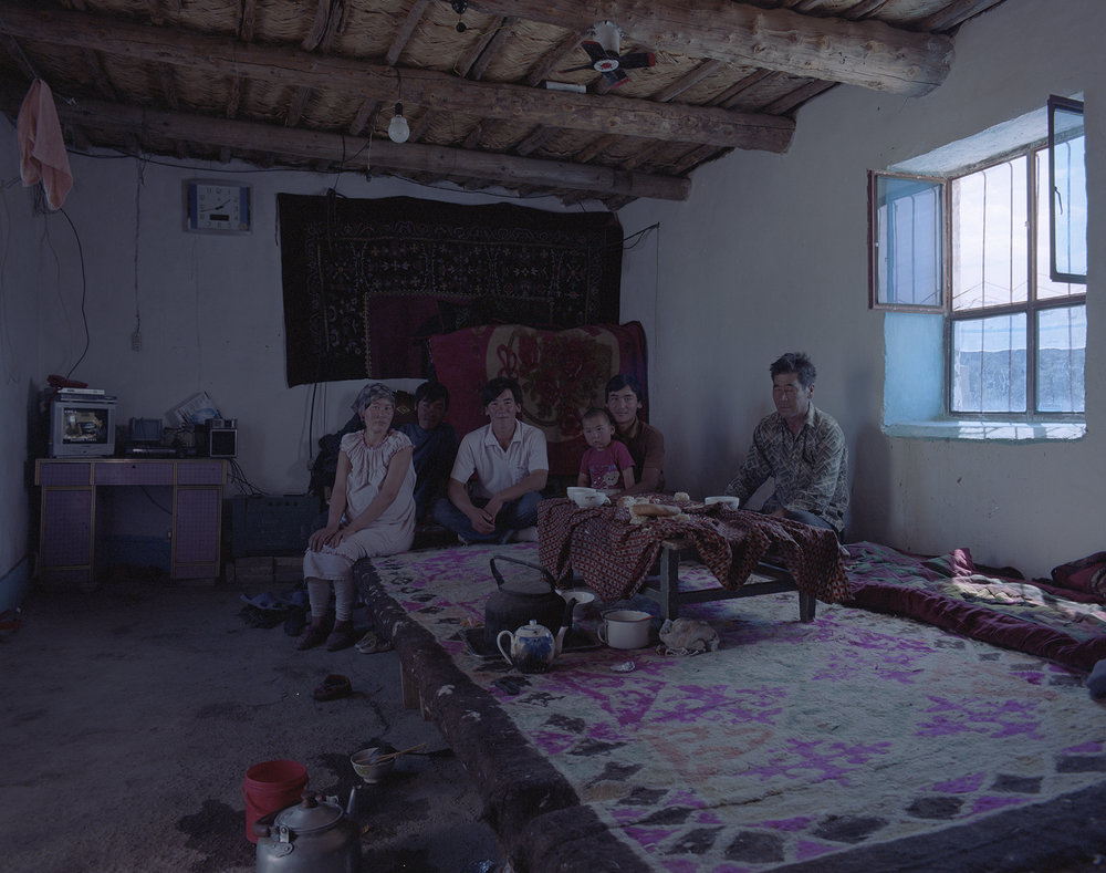 2007 Xinjiang - camel herding family at home. I got my first camel milk to drink.