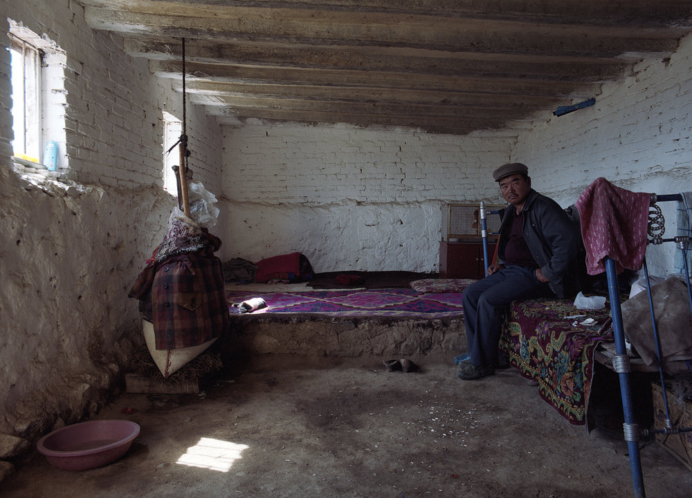 2007 Xinjiang - a Mongolian cheese maker in his summer home.