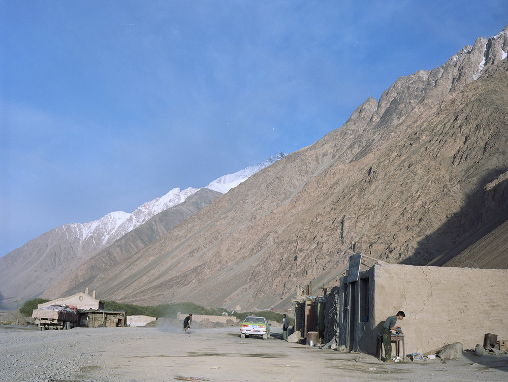 2007 Xinjiang - Mazar, two guesthouses and a truck repair place.