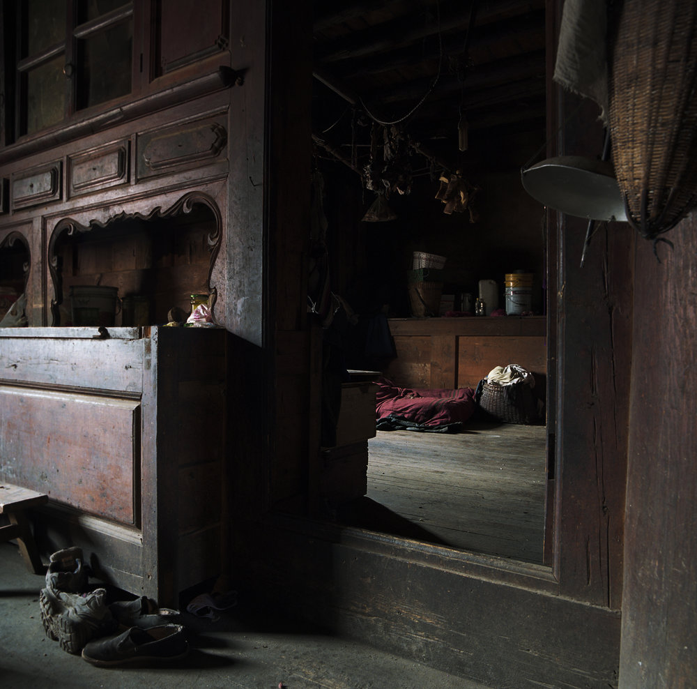 2010, Gezan - one of the sons in this house is a high monk. He has his own room and the family has to take care  that they keep certain Tibetan religious rules.