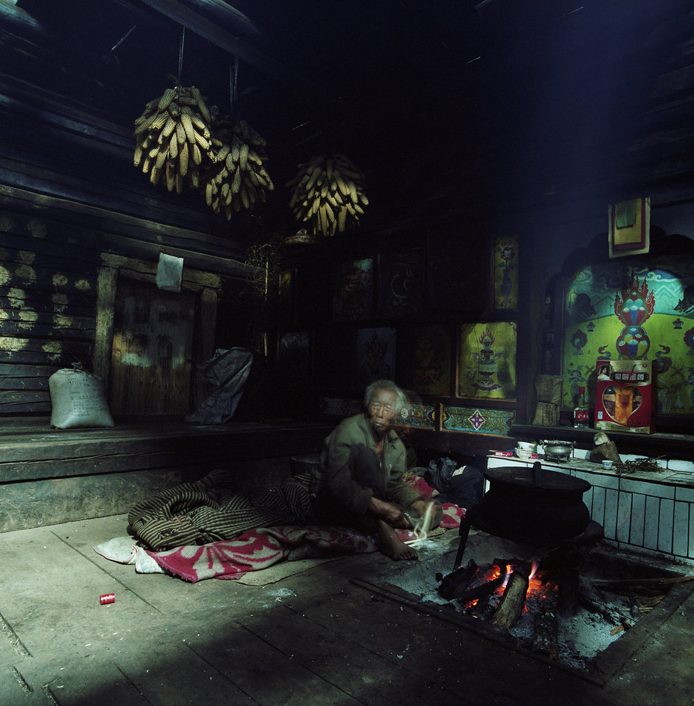 2010, in the vicinity of Lugu Lake - a Moso home. The brother in the house of his sister.