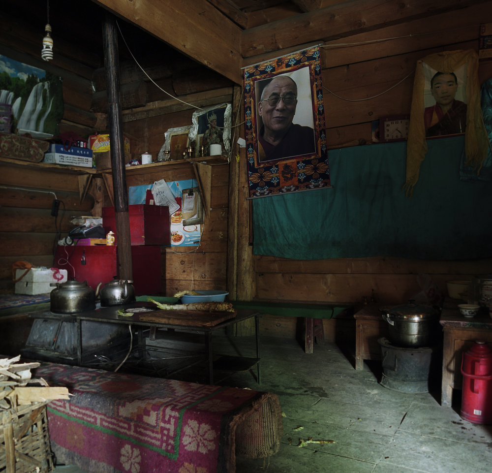 2010, Lijiu - GatTe Leh kitchen. In this area seeing pictures of the Dalai Lama is very normal.