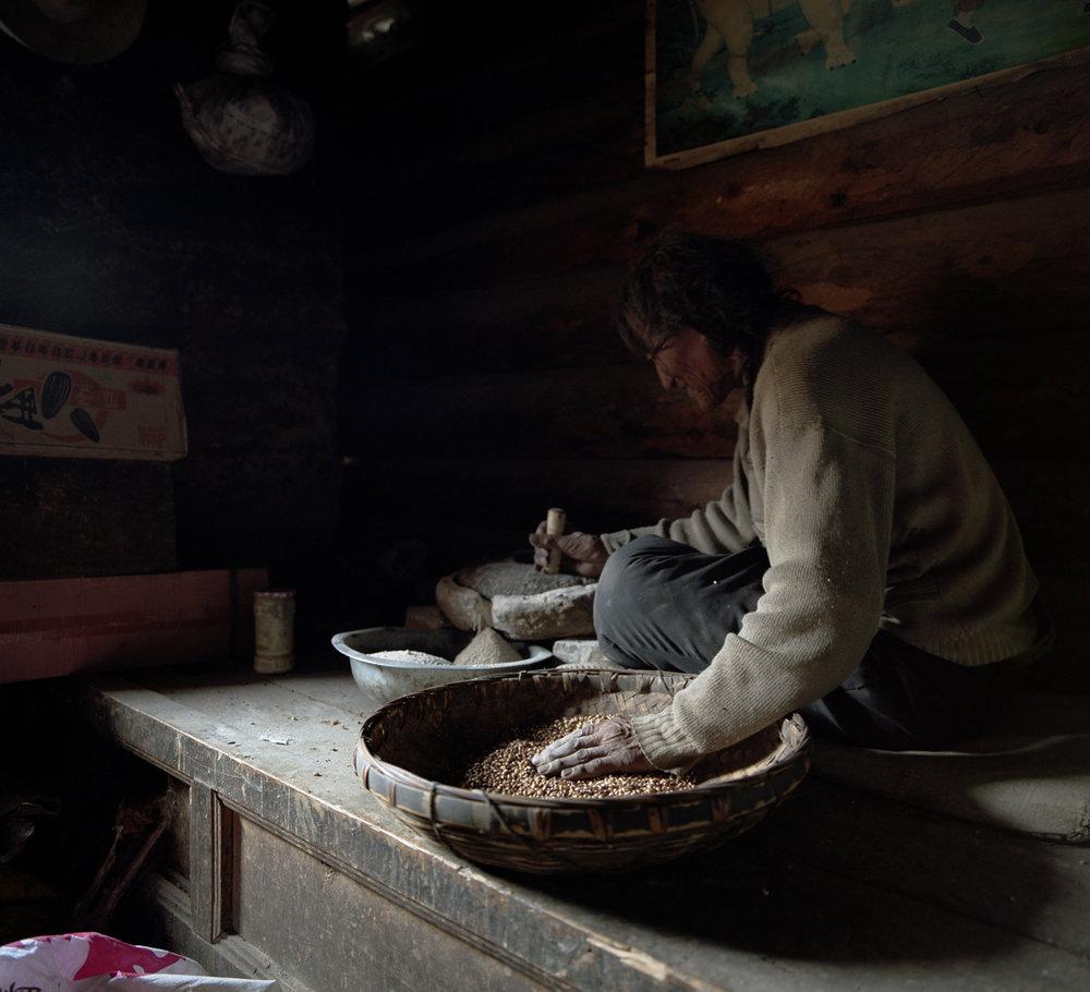 2010, near Maniggago - grinding flour.