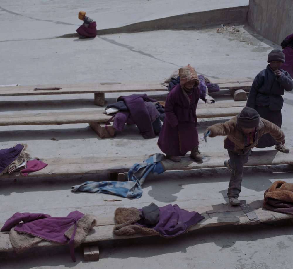 2010, near Bayu - monks playing in their school during the break.