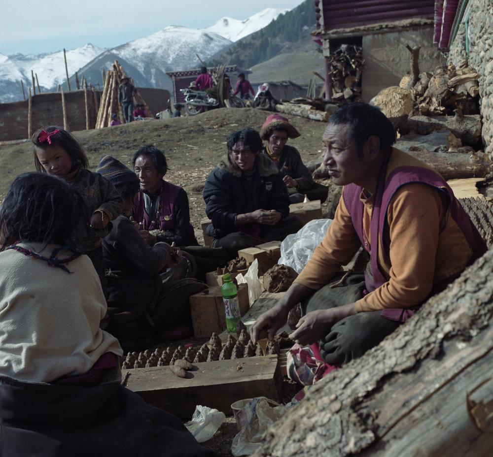 2010, near Litang - festival in the village. They are making ritual clay figurines. The more you make the beter.