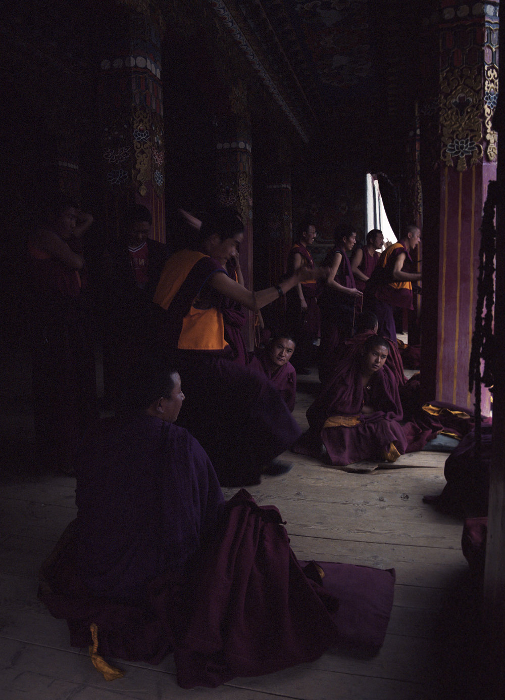 2010, near Kandze - discussing monks. This practice is n important part of their training.