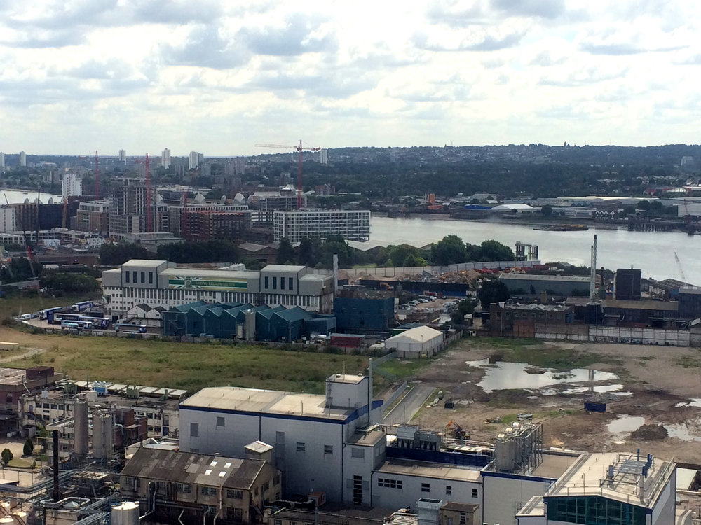 The working Tate and Lyle Sugar Refinery sits upon retained industrial land whilst development enshrouds it