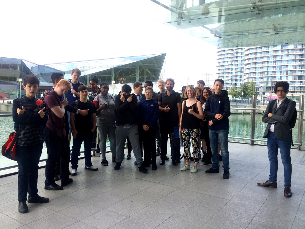 Sam and Alice pose for a group photo with the students from the Academy after braving the heights of the Emirates Air Line