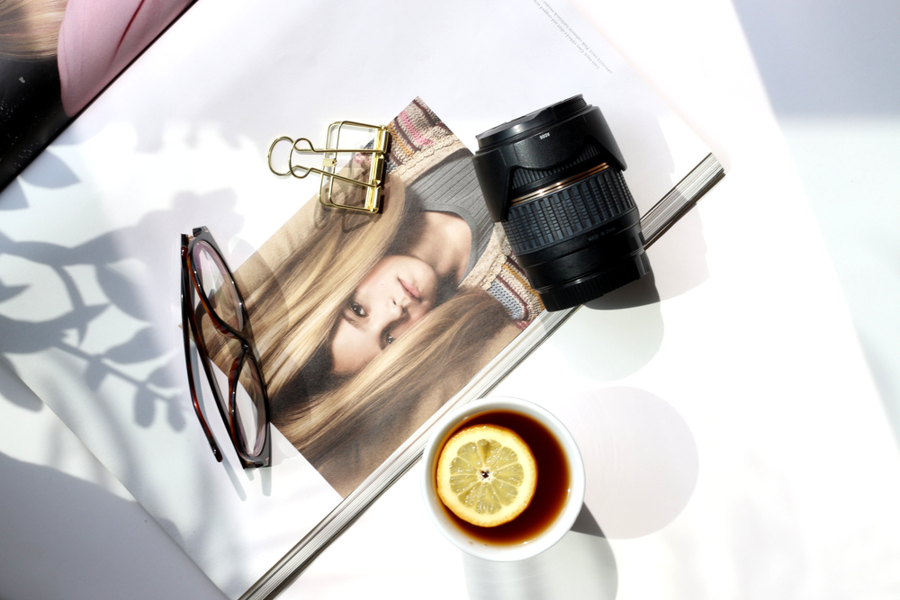 Flatlay image styling with natural light direct sunlight. Very minimal flatlay with few items.