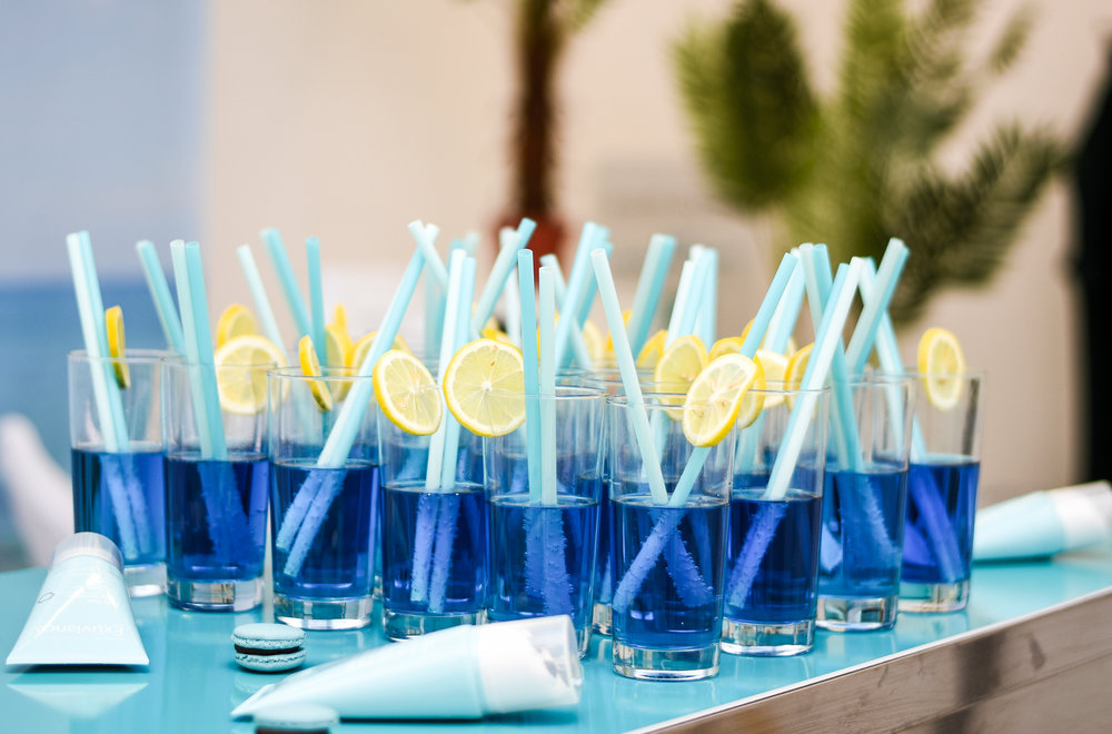 Picture form Exuviance event featuring blue cocktails and summer inspired table styling at a beauty and skincare event.