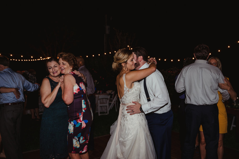 bride-and-groom-dancing-together-during-the-wedding-reception.jpg