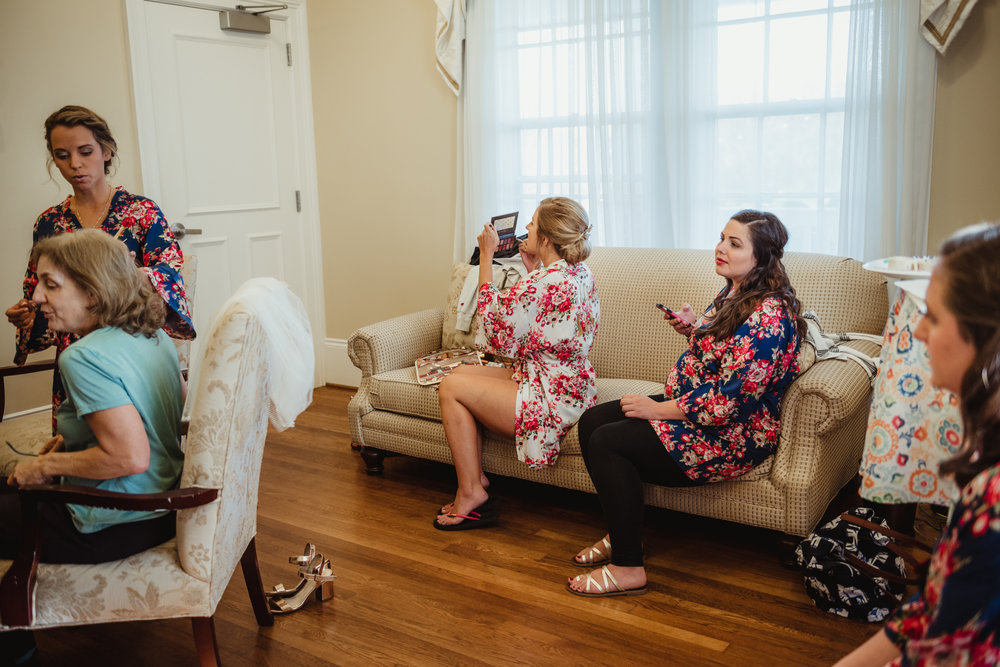 bride-getting-ready-with-her-bridesmaids.jpg