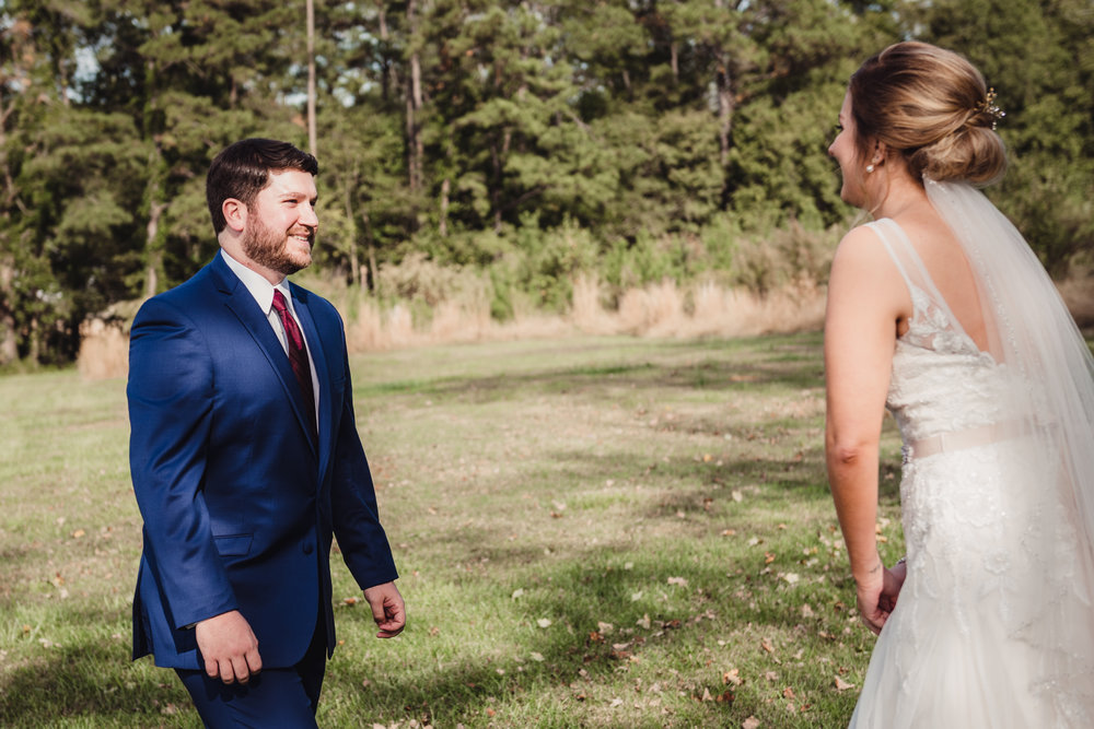 Groom-seeing-his-bride-for-the-first-look.jpg