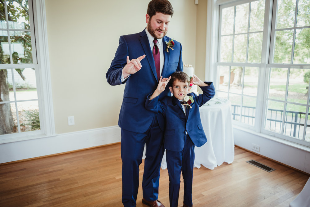 The-groom-and-his-nephew-doing-the-wolfpack-sign.jpg