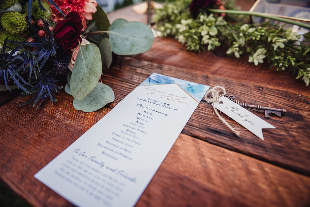 wedding-stationary-telling-details-along-with-an-old-key-for-thank-you.jpg