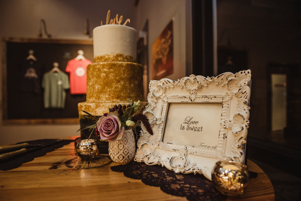 black-and-white-and-gold-wedding-cake-have-a-slice.jpg