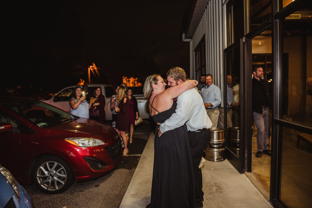 bride-and-groom-do-their-first-dance-outside-of-the-brewery.jpg