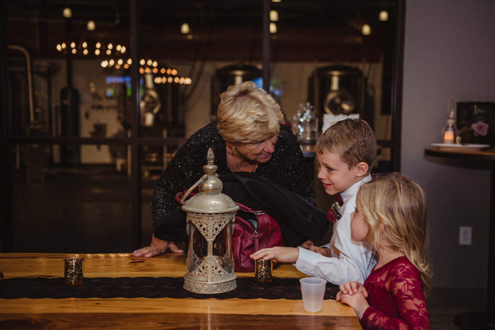 grandma-talking-to-her-grandkids-at-the-wedding-reception.jpg
