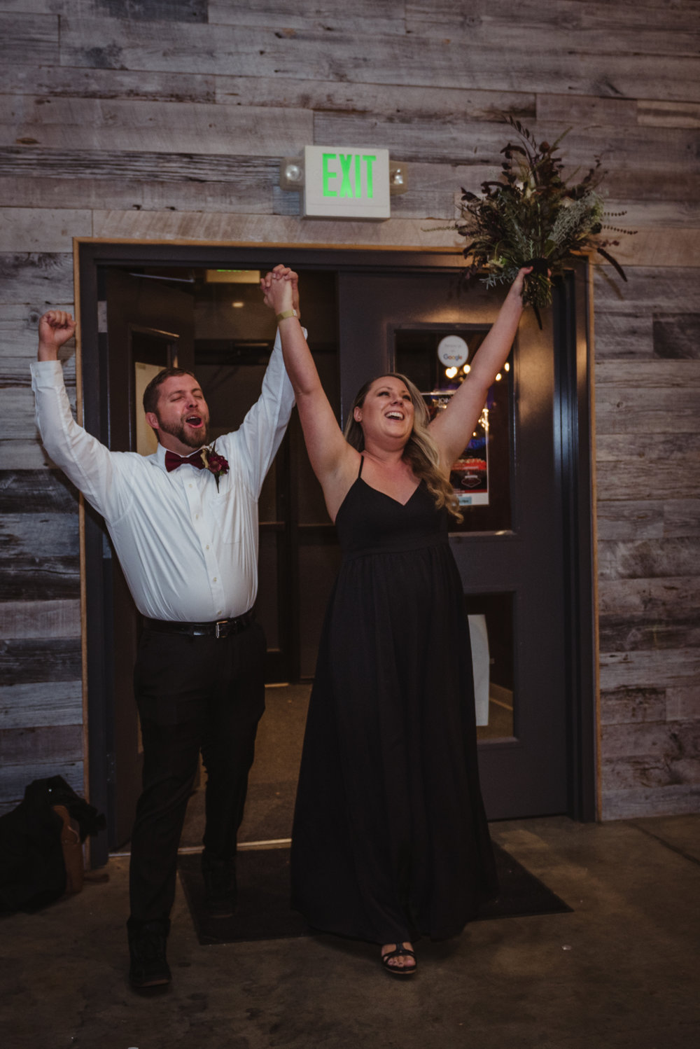 the-bride-and-groom-enter-the-reception-at-the-brewery-for-the-first-time.jpg