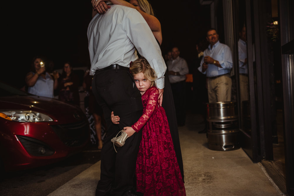 the-bride-and-grooms-daughter-wants-to-be-a-part-of-the-first-dance.jpg
