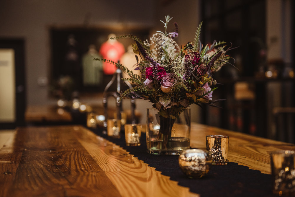 the-foraged-fall-bridesmaid-bouquet-atop-a-black-lace-table-with-gold-accents.jpg