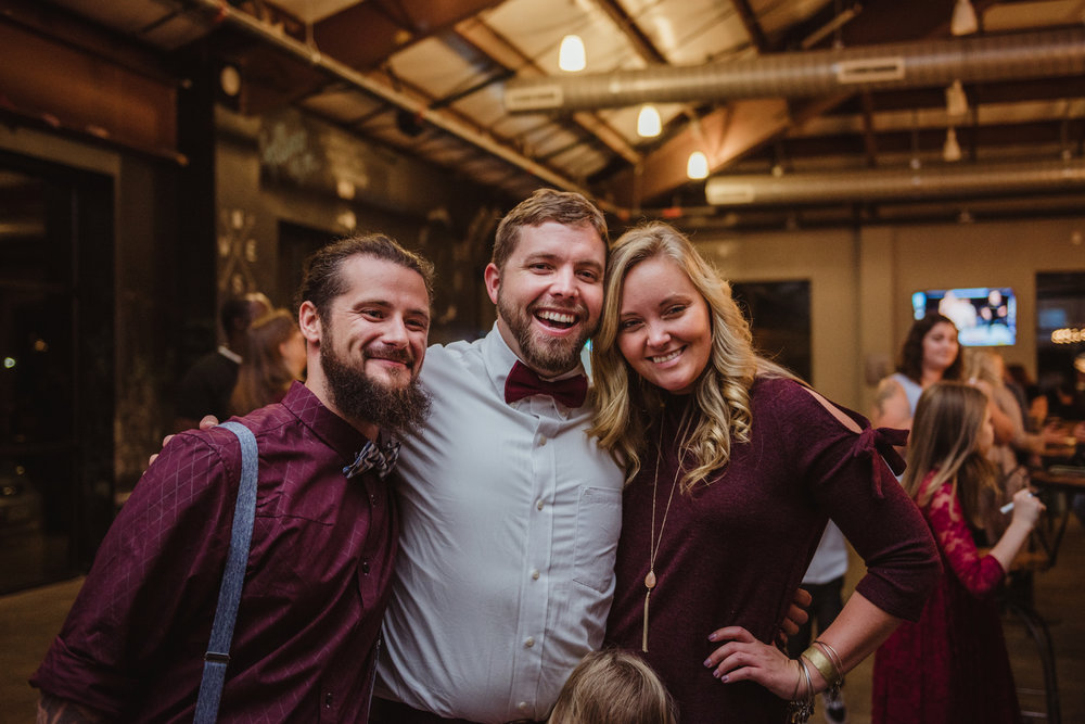 the-groom-poses-with-some-wedding-guests.jpg