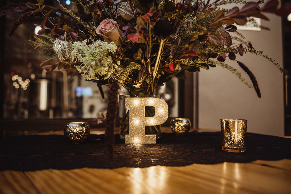 wedding-details-such-as-the-bridal-bouquet-and-a-light-up-letter-p.jpg