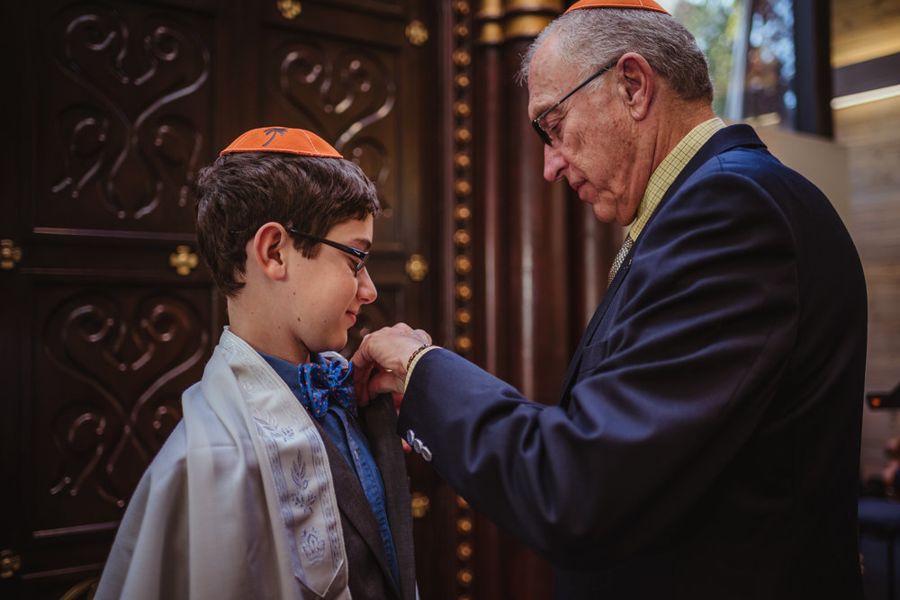bar-mitzvah-boy-being-pinned-by-his-grandpa.jpg