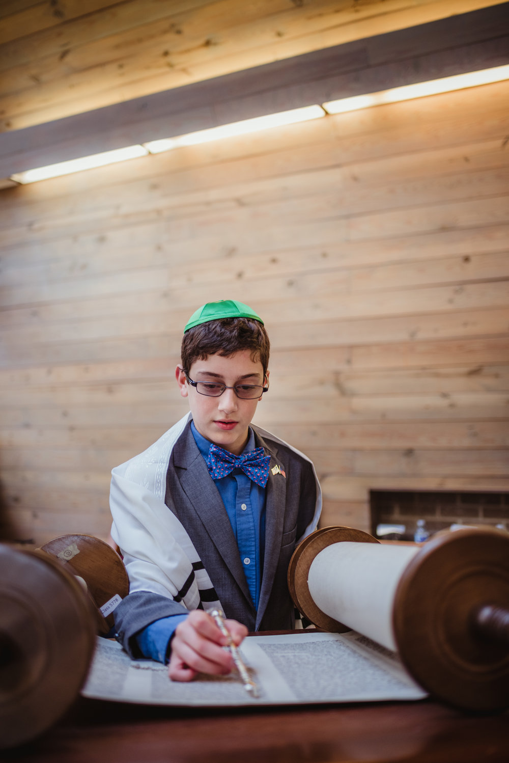 Mitzvah-boy-reading-from-the-torah-on-the-bima-in-Raleigh.jpg