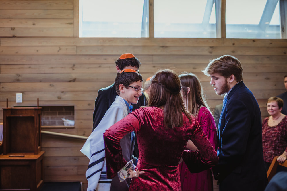 congratulated-by-family-after-the-mitzvah-ceremony-in-Raleigh.jpg