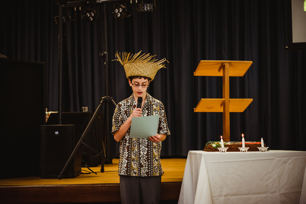 the-mitzvah-boy-reciting-his-speech-as-he-lights-the-candles.jpg
