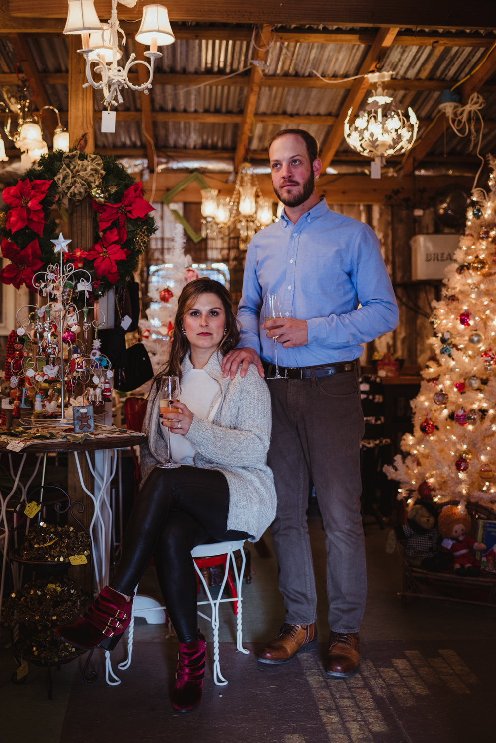 a-perfect-pose-among-the-christmas-decorations-at-their-engagement-session.jpg
