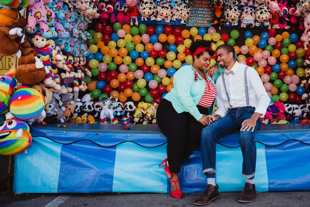 snuggling-together-in-front-of-the-balloons-at-the-NC-State-fair.jpg